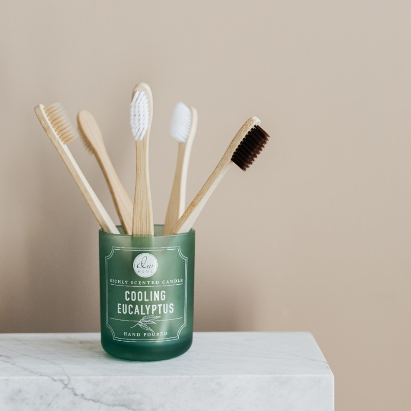 bamboo toothbrushes in glass jar