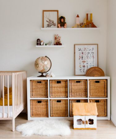 floating shelves in children bedroom with wooden furniture and toys