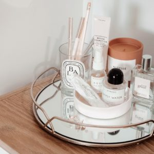 makeup set with tray in bathroom