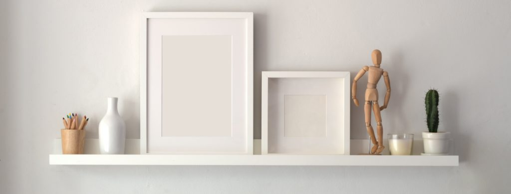 white wall with floating shelf